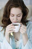 Woman having herbal tea