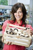 Woman in store with mushrooms