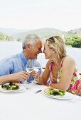 An older couple having lunch on a boating holiday