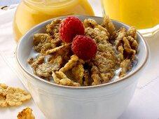Wholemeal cornflakes with raspberries; honey; orange juice