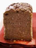 Wholemeal bread with oat flakes on red napkin