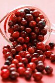 Cranberries falling out of measuring jug
