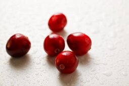 A few cranberries with drops of water