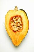 Half an acorn squash with seeds