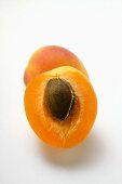 Whole apricot and half an apricot