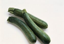 Three young courgettes