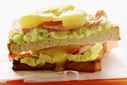 Ham and cheese on toast with pineapple and avocado cream