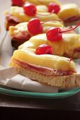 Ham and cheese on toast with cocktail cherry