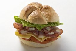 Ham, cheese, tomato and lettuce in a bread roll