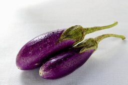 Two aubergines with drops of water