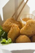Chicken Nuggets with sweet and sour sauce to take away