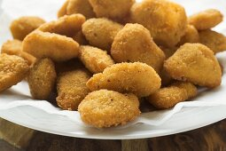 Many chicken nuggets on plate