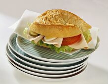 Bread roll filled with cold cuts, egg, gherkin, tomato etc.