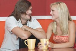 Blond girl and young man in a café or restaurant