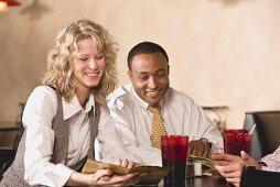 People in restaurant looking at the menu