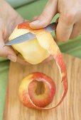 Peeling an apple