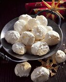 Coconut macaroons on pewter plate