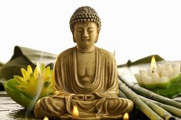 Buddha statue with smoke and water lily candles