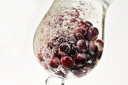 Grapes in a glass of water