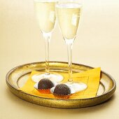 Two Glasses of Champagne with Two Dark Chocolate Truffles