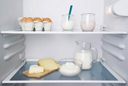 An open fridge with dairy products