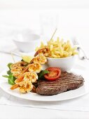 Surf and Turf (beef steak and a prawn kebab) with chips