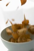 Cereal flakes falling into a cereal bowl