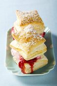 Puff pastries filled with raspberry ice cream & raspberry sauce
