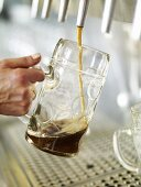 Filling a tankard with Spezi (cola and lemonade)