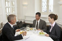Business people having a meal