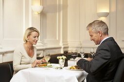 Man and woman eating together in a restaurant