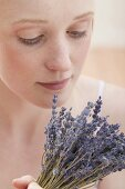 Young woman with dried lavender