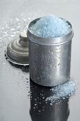 Blue bath salts in metal container