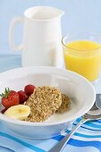 Wheat biscuits with milk, fruit and orange juice