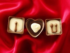 Chocolates on red fabric with the message 'I love U'