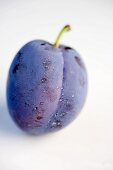 A plum with drops of water