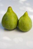 Two fresh green figs
