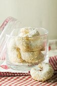 Vanilla crescents with grated coconut in glass jar