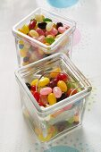 Coloured jelly beans in two storage jars