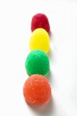 Coloured jelly sweets in a row