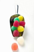 Coloured jelly sweets in metal scoop
