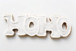The word HOHO in gingerbread with white icing