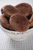Several chocolate buns in white bowl