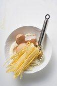 Home-made ribbon pasta, ingredients and pasta wheel