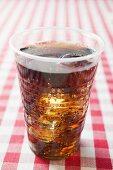 Cola in a plastic beaker