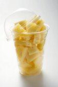 Pineapple chunks in a plastic beaker