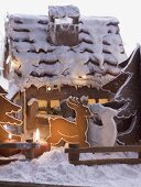 Gingerbread house with gingerbread reindeer