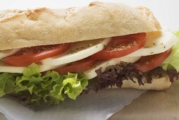 Baguette roll filled with mozzarella and tomato