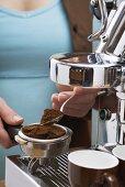 Woman making espresso