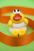 Easter chick with orange ribbon